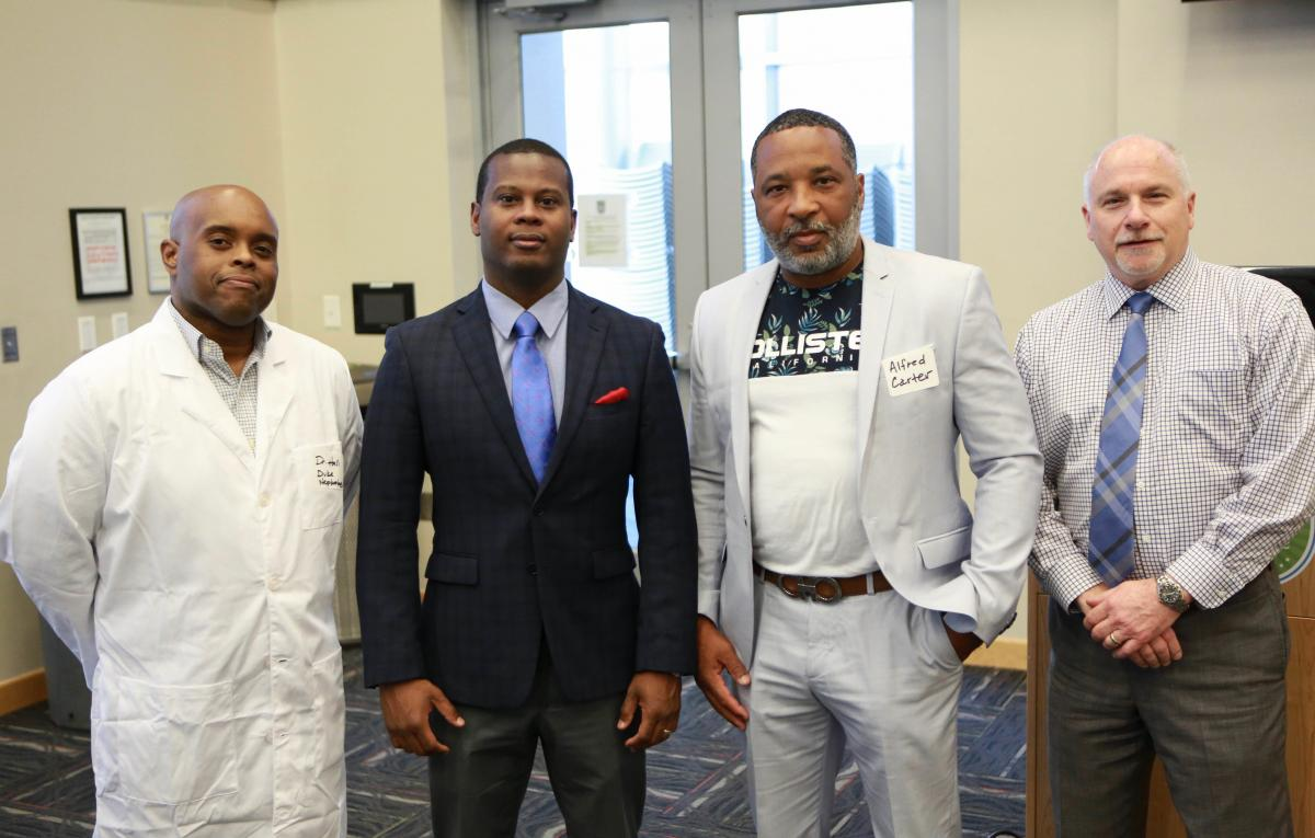 Duke nephrologist Gentzon Hall, MD, PhD, Duke gastroenterologist Julius Wilder, MD, PhD, Alfred Carter, Jr., joined Steven Patierno, PhD, at the Men's Health Forum in Durham last June, a community event hosted by Duke Cancer Institute and the City of Durham. (photo by Glenn Parson)