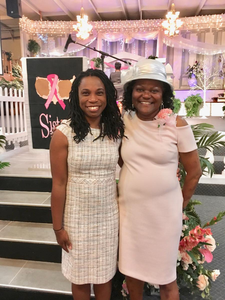 "Lola Fayanju, MD, is actively involved with the Sisters Network Triangle NC, the local branch of a national support group for black women with breast cancer. Fayanju (left) was the keynote speaker at the group's ""Tea for Two"" event held on June 2. Here she is with Valarie Worthy, president of Sisters Network and head of patient navigation at Duke Cancer Institute."