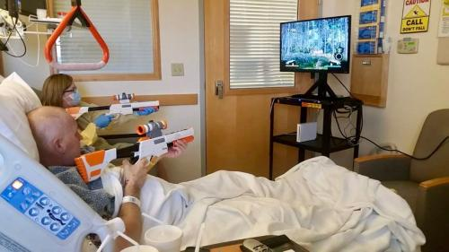 Kristan May and her boyfriend Jey Tyree play a Wii game prescribed by recreation therapist Tiffany Atkinson. Tyree succumbed to leukemia in last fall.