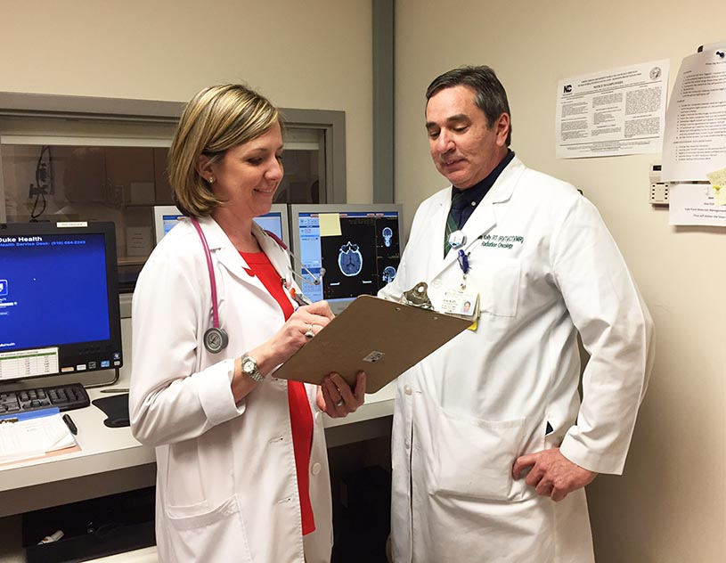 Catherine Sellers consults with Duke Cancer Center Raleigh colleague and lead radiation therapist Tim Kelly.