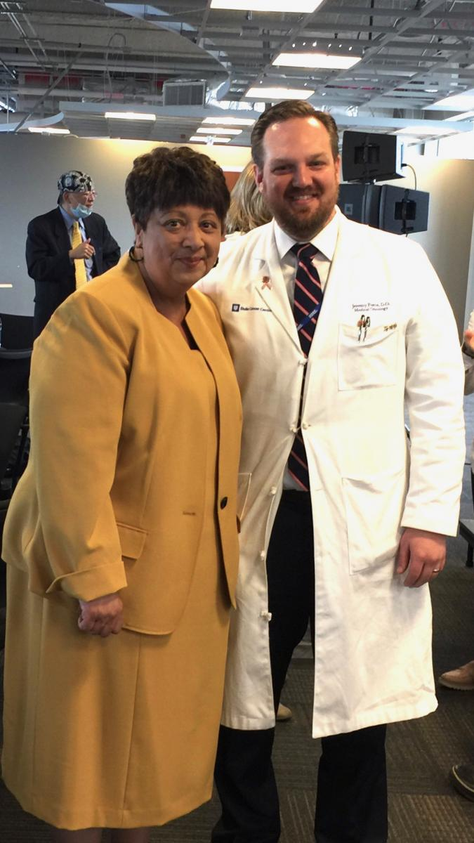 "Inflammatory breast cancer survivor Charlotte Finley said when she first learned of her diagnosis she was ""prepared to die."" However, she said, ""the storm clouds lifted"" when her physician Jeremy Force, MD (right) met with her and said ""we got this."""