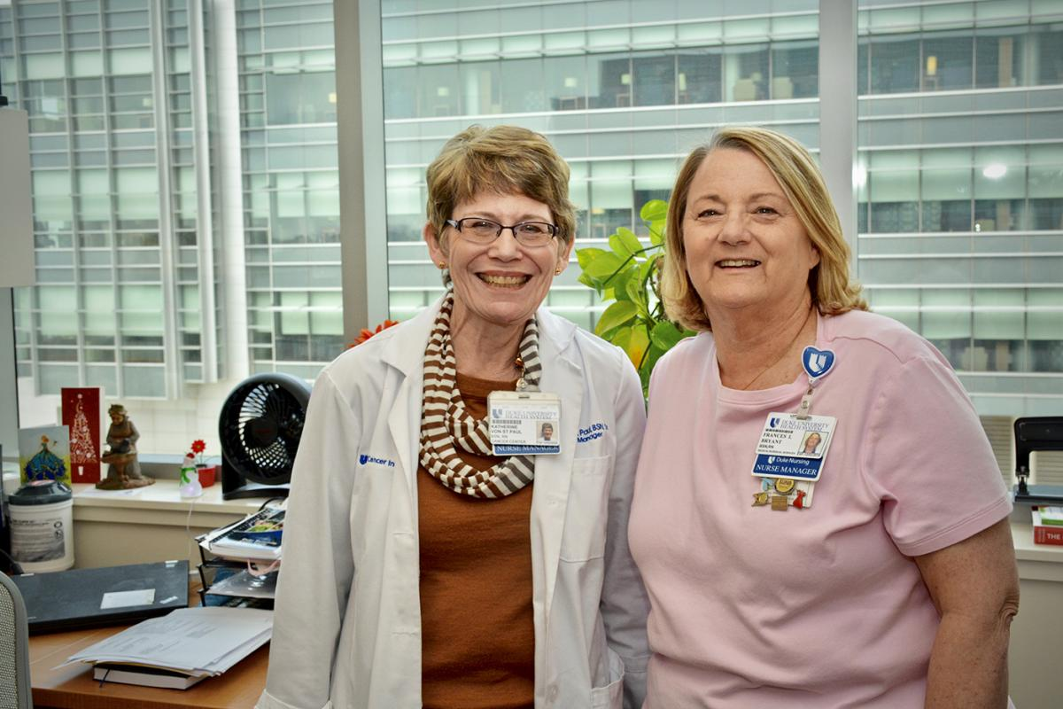 Readying for retirement, Fran Bryant (left) poses with Kathy von St. Paul, RN, BSN, who is assuming Bryant's role as nurse manager for Clinic 5-1.