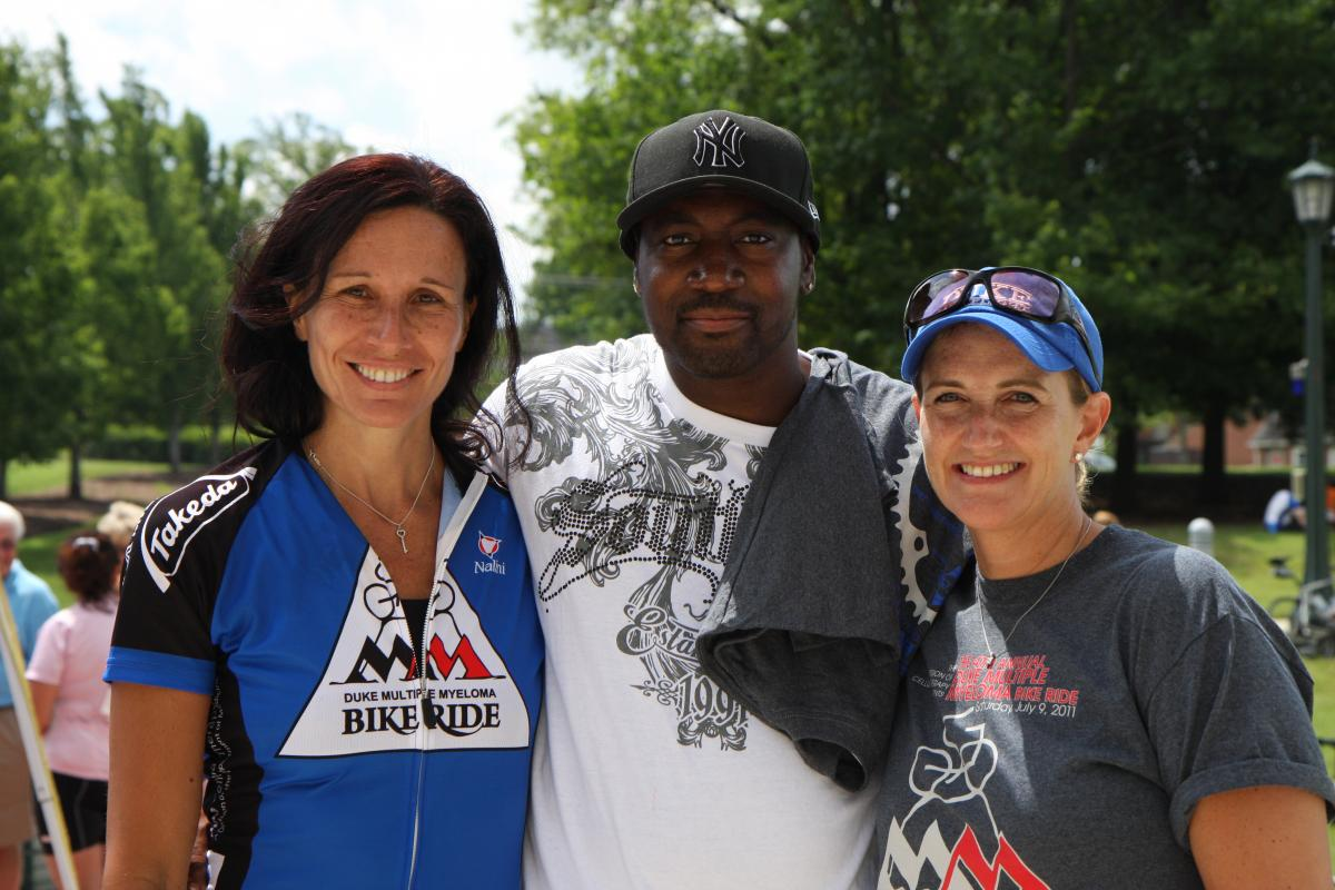At a previous ride, Cristina Gasparetto, MD (left); multiple myeloma survivor and Gasparetto's patient Thomas Goode; and Jennifer Loftis (clinical operations director for Duke Raleigh Hospital Oncology) gather at the finish line.
