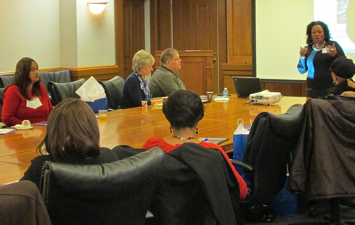 As Janice Campbell and others listen in, Nadine J. Barrett, PhD, MA, MS, director of the Office of Health Equities and Disparities, provides information on available cancer programs and services offered by the DCI and other organizations in the community.