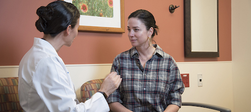 Breast surgical oncologist Jennifer Plichta, MD, counsels Shanel Wilson-Poe on her breast cancer risk. (click photo to learn more)