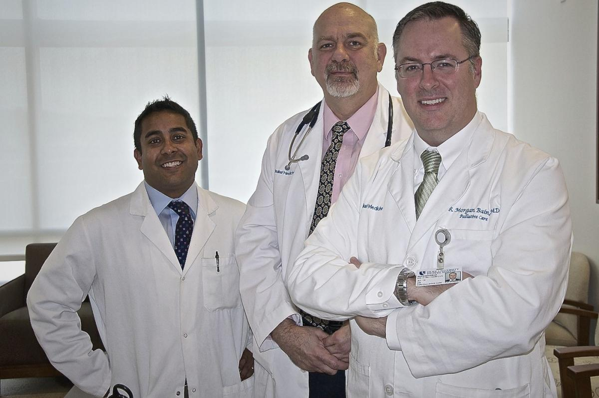 The Duke Cancer Center palliative care team. Pictured from left to right: Arif Kamal, M.D., director of quality outcomes with the Duke Cancer Institute; Mark Waters, M.P.H., A.N.P.-B.C., A.C.H.P.N., Center for Palliative Care; and R. Morgan Bain, M.D., medical director for Duke Outpatient Palliative Care. The Duke QDACT team is made up of clinicians, software developers, informatics specialists, graphic designers, business specialists and academic researchers. Led by Amy Abernethy, M.D., director for the Center for Learning Health Care and director of the Duke Cancer Care Research Program, the team focuses on data systems, technology development, health policy, patient reported outcomes, and patient-centered care.