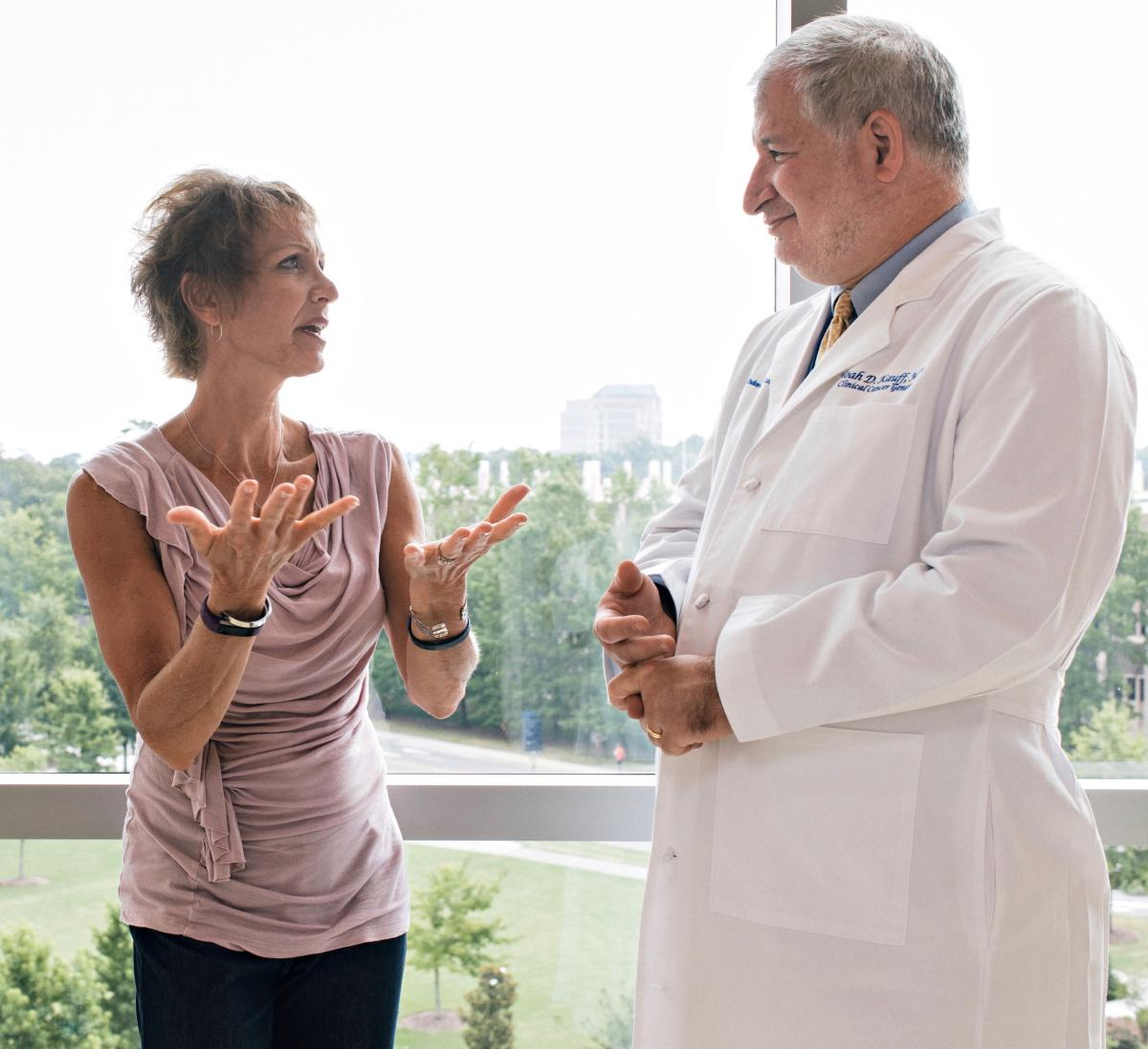 TWO-TIME BREAST CANCER SURVIVOR: Kate Houff with clinical cancer geneticist Noah Kauff, MD (photo by Alex Boerner)