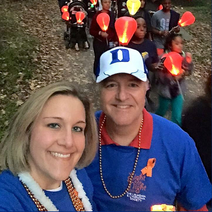 Nicole Kenney poses with her father at an earlier Light The Night Walk in Raleigh.