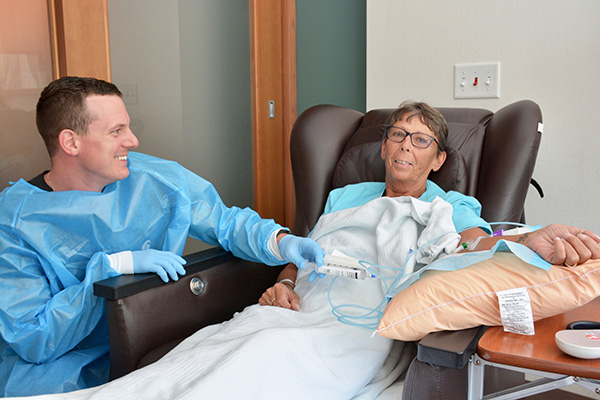 """McMichael provides infusion for Elizabeth Woodlief, who is battling stage 3 non small cell lung cancer. """"He treats me wonderfully,"""" she quipped."""