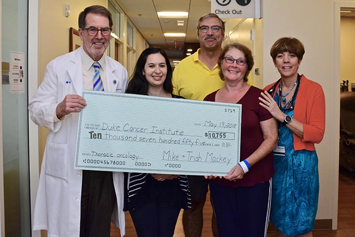 Trish Mackey presents a check for more than $10,755 to Jeffrey Crawford, MD. Also pictured: Aviva Emmons, RN; Michael Mackey; and Susan Blackwell, PA.