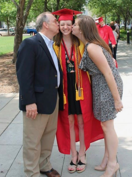 Katie, an executive recruiter who works in Raleigh with her father, joins him in congratulating Megan (center) on her graduation from college a couple years ago. Their father came to every doctor's appointment and gave them his full support.