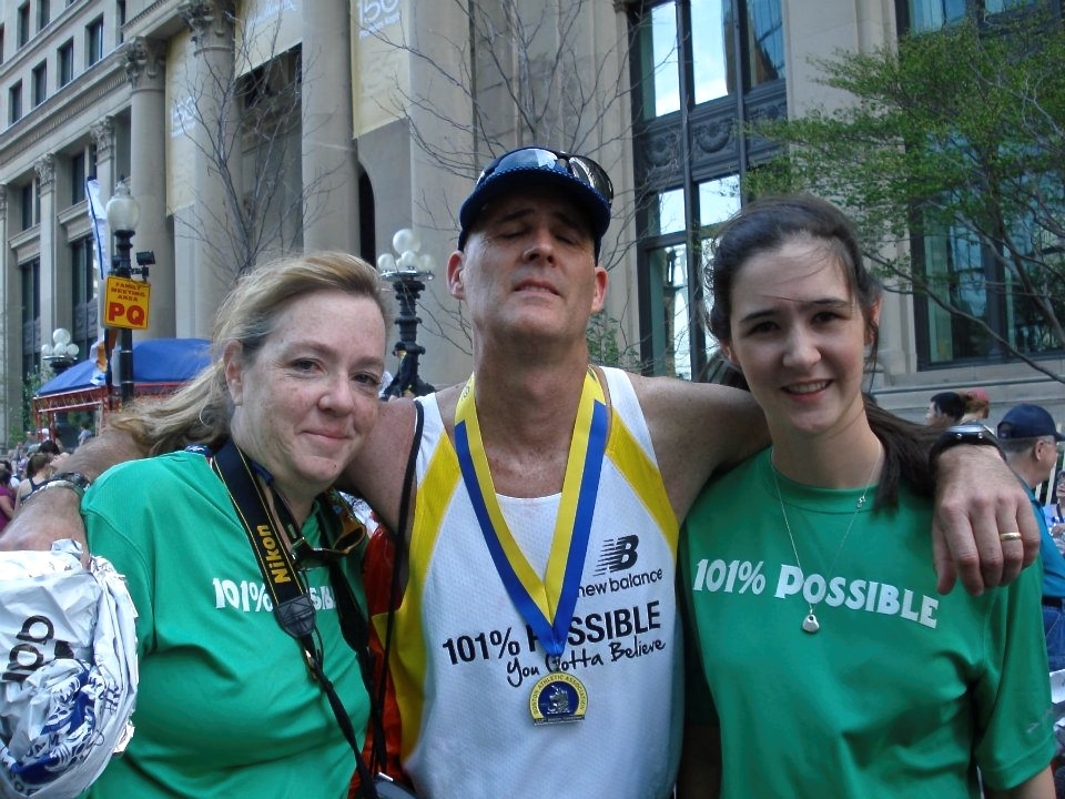 One year to the day after his second surgery and two days after taking his last dose of chemo, Tom O'Donnell completes the 2014 Boston Marathon on April 21. Utterly exhausted, O'Donnell is flanked by his biggest fans, his wife, Mary, and daughter, Kerry.
