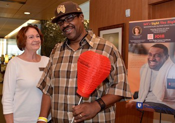 Anthony Bethea, who's being treated for chronic lymphocytic leukemia (CLL) and small lymphocytic lymphoma (SLL), stands with Pat Luke, CLL survivor and volunteer for Light the Night.