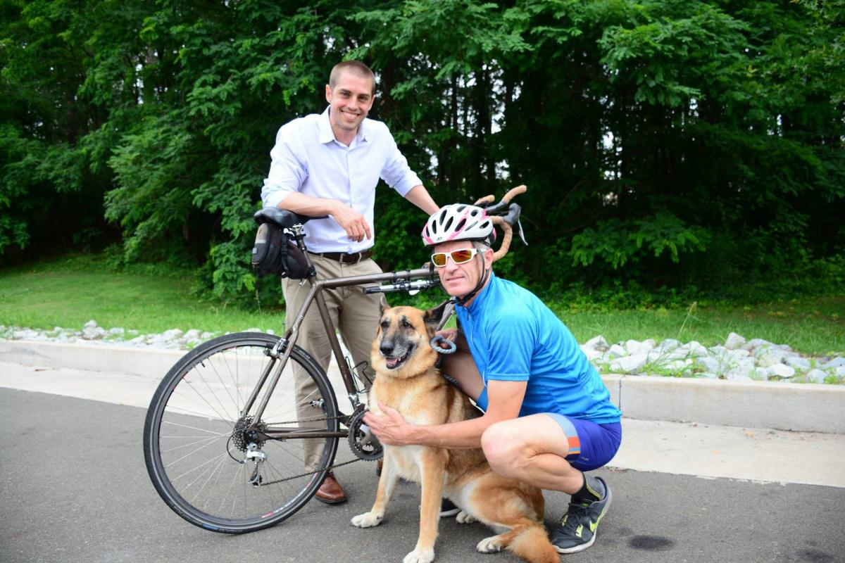 Paul Rudershausen will bike across North America this summer to raise funds to support his friend Jason Somarelli's research.  Somarelli (left), with Duke Cancer Institute's Canine Comparative Oncology group, studies the genes that promote metastasis in both dogs and humans.