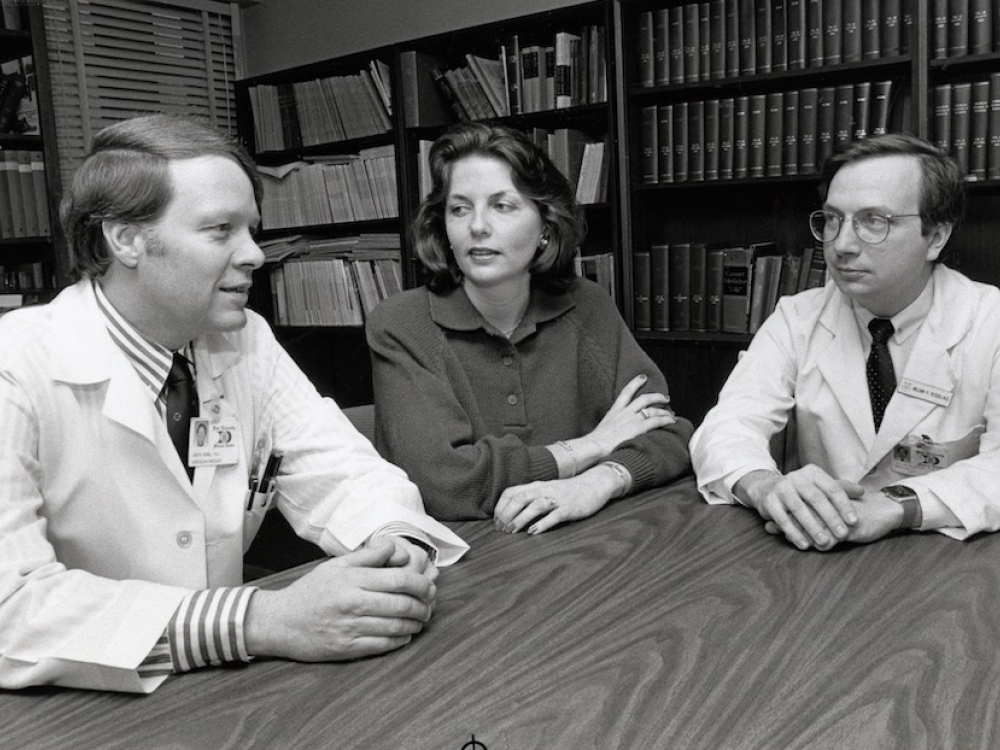 Archival photo of Joseph Moore, MD, (unknown woman) and Bill Peters, MD